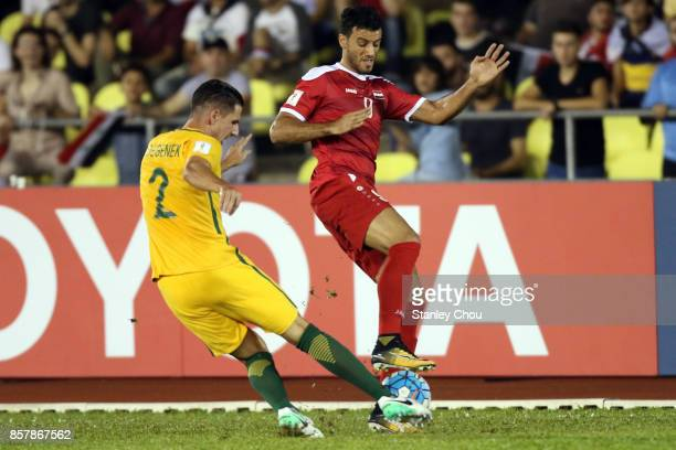 Milos Degenek of Australia battles with Omar Alsoma of Syria during the 2018 FIFA World Cup Asian Playoff match between Syria and the Australia...