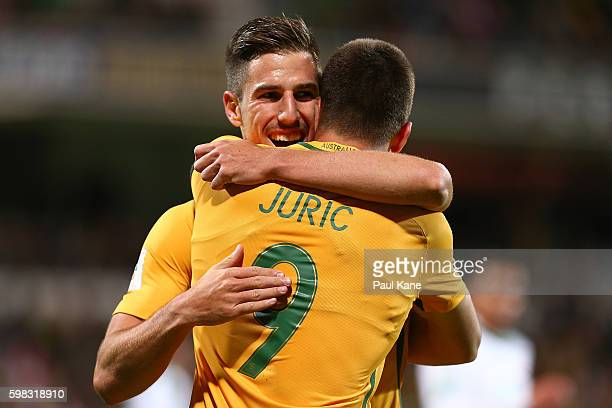 Milos Degenek of Australia congratulates Tom Juric after scoring a goal during the 2018 FIFA World Cup Qualifier match between the Australian...