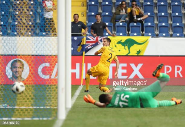 Milos Degenek of Australia looks on as his shot goes in for a goal from a deflection during the International Friendly match between the Czech...