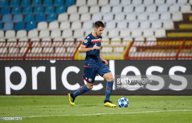 Milos Degenek of Crvena Zvezda in action during the UEFA Champions League Play Off First Leg match between FK Crvema Zvezda and FC Red Bull Salzburg...