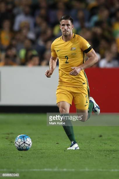 Milos Degenek of the Socceroos runs the ball forward during the 2018 FIFA World Cup Qualifier match between the Australian Socceroos and United Arab...