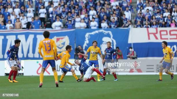 Milos Degenek of Yokohama FMarinos and Hiroaki Okuno of Vegalta Sendai compete for the ball during the JLeague J1 match between Vegalta Sendai and...