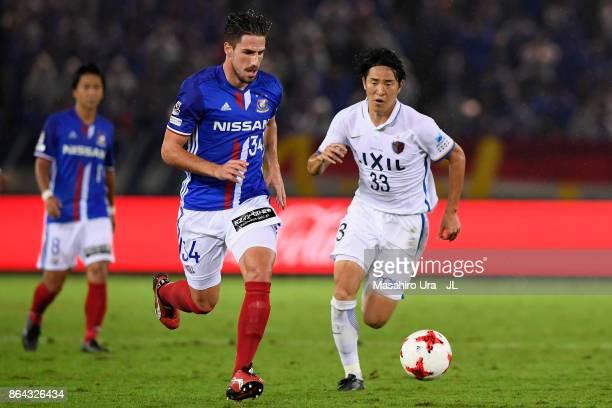 Milos Degenek of Yokohama FMarinos and Mu Kanazaki of Kashima Antlers compete for the ball during the JLeague J1 match between Yokohama FMarinos and...