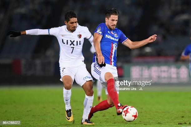 Milos Degenek of Yokohama FMarinos controls the ball under pressure Pedro Junior of Kashima Antlers during the JLeague J1 match between Yokohama...