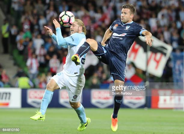 Milos Dimitrijevic of Sydney FC and Luke Brattan of City compete for the ball during the round 21 ALeague match between Melbourne City and Sydney FC...