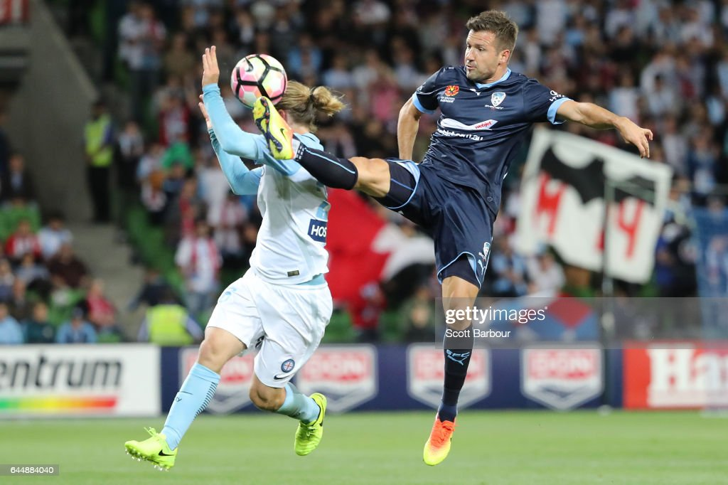 Milos Dimitrijevic of Sydney FC and Luke Brattan of City compete for the ball during the round 21 A-League match between Melbourne City and Sydney FC at AAMI Park on February 24, 2017 in Melbourne, Australia.