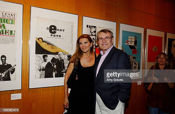 Milos Forman and wife Martina stand in front of a 1963 Czech Film poster of Peter and Paula which was one of several early films the director made...