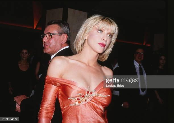 Milos Forman in the background looks to his right Courtney Love looks to her left in the foreground they arrive at ACLU Torch of Liberty Dinner at...