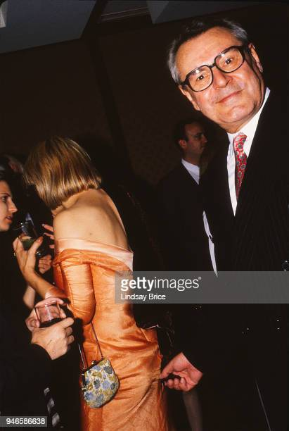 Milos Forman joking for the camera in the humor of times past mischievously pretends to pinch his friend Courtney Love but is actually pinching only...