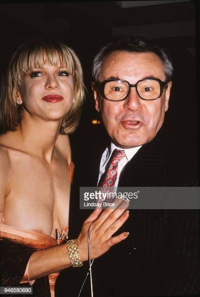Milos Forman reacts as if scandalized by Courtney Love's wardrobe malfunction as they arrive for the ACLU Torch of Liberty Dinner honoring Forman for...