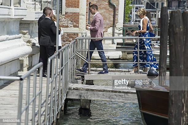 Milos Ivanovic and Dragana Ivanovic arrive at the Aman Grand Canal hotel after the celebration of Bastian Schweinsteiger and Ana Ivanovic marriage on...