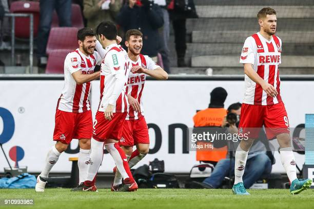 Milos Jojic of 1FC Koeln celebrates with his teammates after scoring his teams first goal to make it 10 during the Bundesliga match between 1 FC...