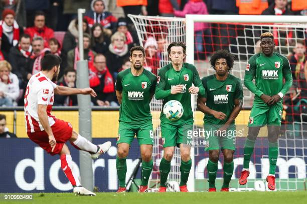 Milos Jojic of 1FC Koeln scores his teams first goal over Aufsburgs wall to make it 10 during the Bundesliga match between 1 FC Koeln and FC Augsburg...