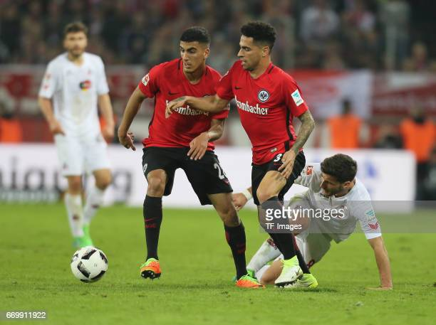 Milos Jojic of Cologne and Omar Mascarell of Eintracht Frankfurt and Aymen Barkok of Eintracht Frankfurt battle for the ball during the German...