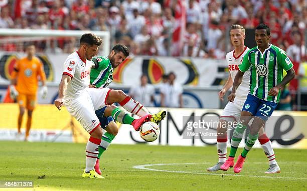 Milos Jojic of Cologne challenges Vieirinha of Wolfsburg during the Bundesliga match between 1 FC Koeln and VfL Wolfsburg at RheinEnergieStadion on...
