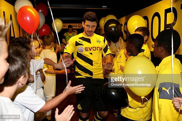 Milos Jojic of Dortmund wwelcomes the ball children in the tunnel prior to the Bundesliga match between Borussia Dortmund and VfB Stuttgart at Signal...