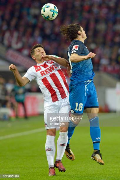 Milos Jojic of FC Koeln and Nico Schulz of Hoffenheim battle for the ball during the Bundesliga match between 1 FC Koeln and TSG 1899 Hoffenheim at...
