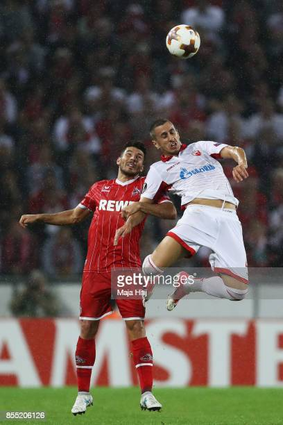 Milos Jojic of FC Koeln battles for the ball with Aleksandar Pesic of Crvena zvezda during the UEFA Europa League group H match between 1 FC Koeln...