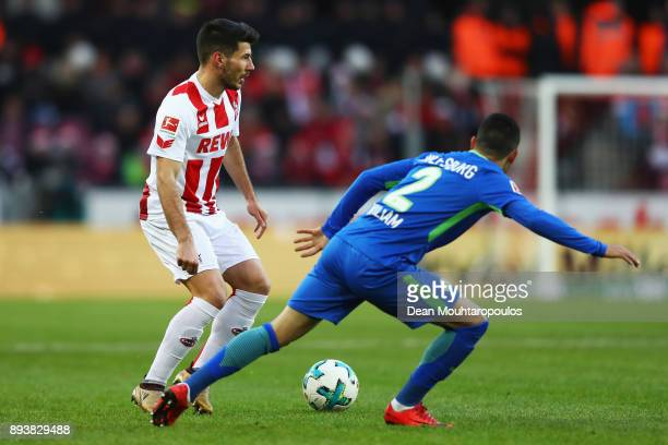 Milos Jojic of FC Koeln battles for the ball with William of Wolfsburg during the Bundesliga match between 1 FC Koeln and VfL Wolfsburg at...