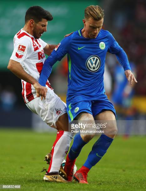 Milos Jojic of FC Koeln battles for the ball with Yannick Gerhardt of Wolfsburg during the Bundesliga match between 1 FC Koeln and VfL Wolfsburg at...