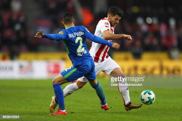 Milos Jojic of FC Koeln gets past the tackle from William of Wolfsburg during the Bundesliga match between 1 FC Koeln and VfL Wolfsburg at...