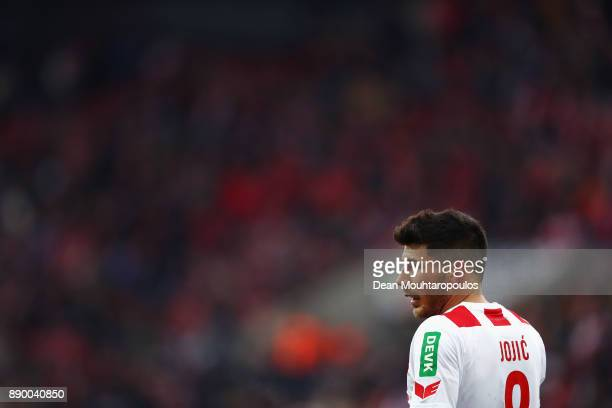 Milos Jojic of FC Koeln looks on during the Bundesliga match between 1 FC Koeln and SportClub Freiburg at RheinEnergieStadion on December 10 2017 in...