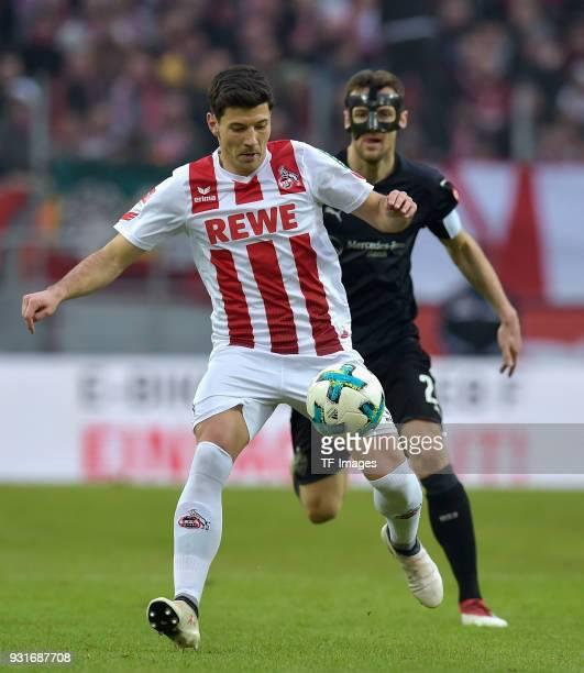 Milos Jojic of Koeln and Christian Gentner of Stuttgart battle for the ball during the Bundesliga match between 1 FC Koeln and VfB Stuttgart at...