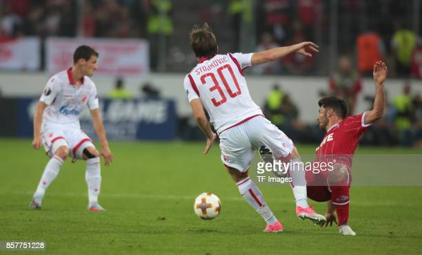 Milos Jojic of Koeln and Filip Stojkovic of Belgrad battle for the ball during the UEFA Europa League group H match between 1 FC Koeln and Crvena...