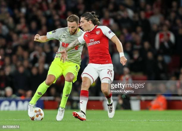 Milos Jojic of Koeln and Hector Bellerin of Arsenal battle for the ball during the UEFA Europa League group H match between Arsenal FC and Koln at...