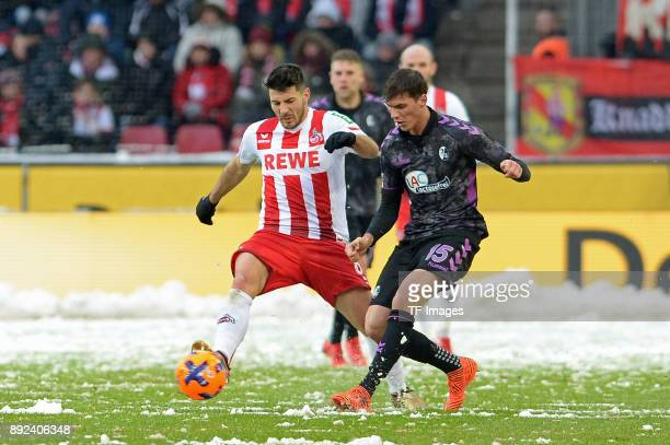 Milos Jojic of Koeln and Pascal Stenzel of Freiburg battle for the ball during the Bundesliga match between 1 FC Koeln and SportClub Freiburg at...