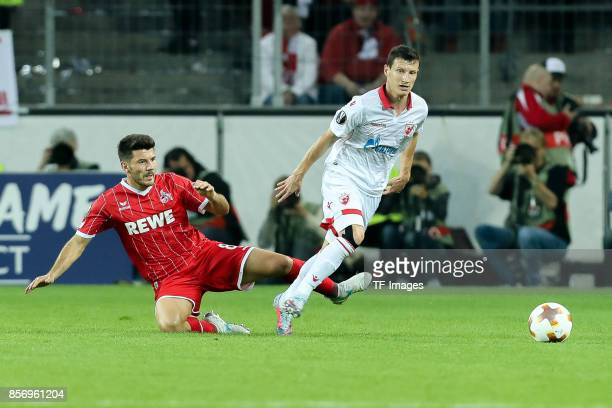 Milos Jojic of Koeln and Slavoljub Srnic of Belgrad battle for the ball during the UEFA Europa League group H match between 1 FC Koeln and Crvena...