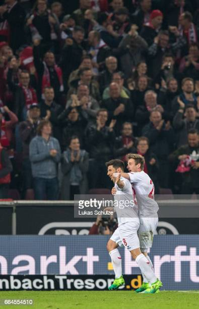 Milos Jojic of Koeln celebrates his teams first goal with Lukas Kluenter of Koeln during the Bundesliga match between 1 FC Koeln and Eintracht...