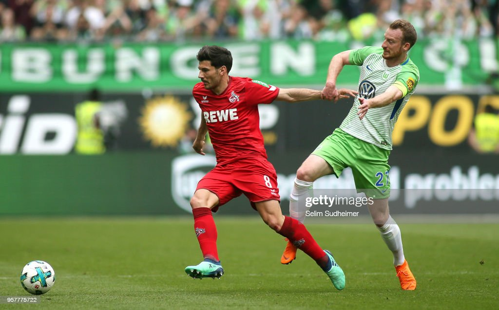 Milos Jojic of Koeln (L) fights for the ball with Maximilian Arnold during the Bundesliga match between VfL Wolfsburg and 1. FC Koeln at Volkswagen Arena on May 12, 2018 in Wolfsburg, Germany.