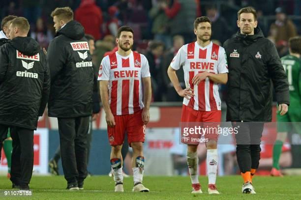 Milos Jojic of Koeln Jonas Hector of Koeln Thomas Kessler of Koeln looks dejected during the Bundesliga match between 1 FC Koeln and FC Augsburg at...