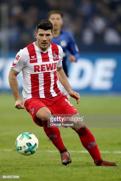 Milos Jojic of Koeln runs with the ball during the Bundesliga match between FC Schalke 04 and 1 FC Koeln at VeltinsArena on December 2 2017 in...