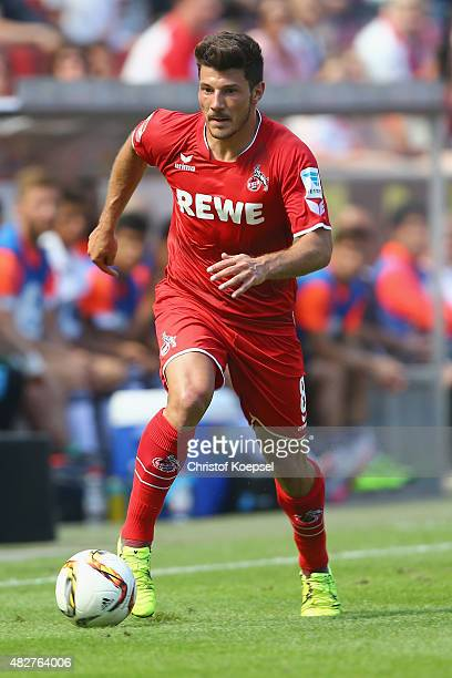 Milos Jojic of Koeln runs with the ball during the Colonia Cup 2015 match between 1 FC Koeln and FC Valencia at RheinEnergieStadion on August 2 2015...