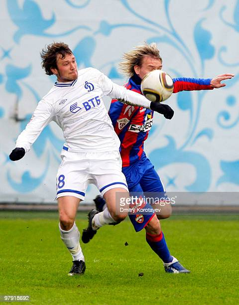 Milos Krasic of PFC CSKA Moscow battles for the ball with Edgaras Cesnauskis of FC Dynamo Moscow during the Russian Football League Championship...
