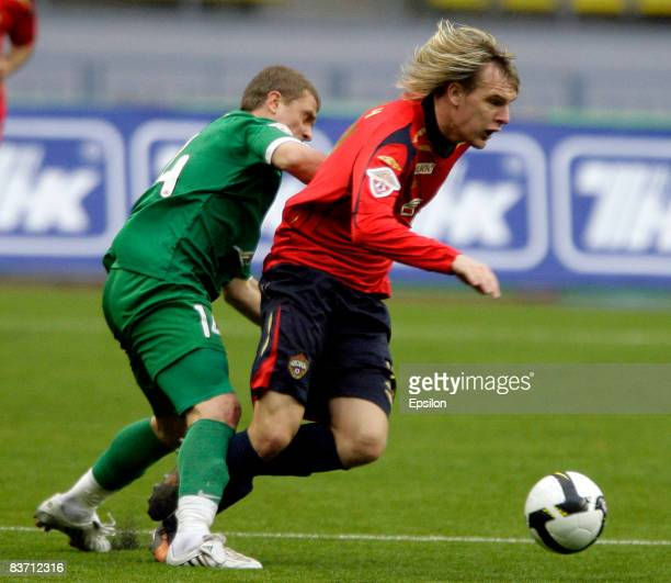 Milos Krasic of PFC CSKA Moscow battles for the ball with Serhiy Rebrov of FC Rubin Kazan during the Russian Football League Championship match...