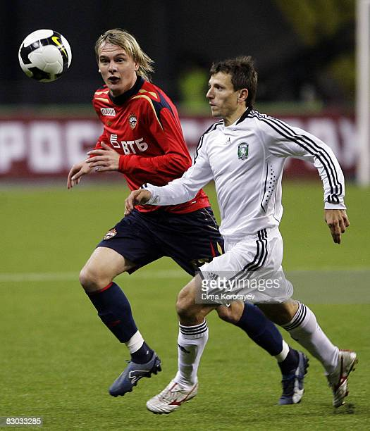 Milos Krasic of PFC CSKA Moscow competes for the ball with Sergei Skoblyakov of FC Tom Tomsk during the Russian Football League Championship match...