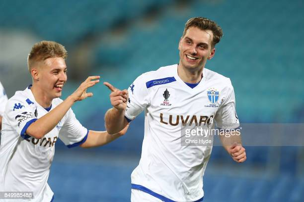Milos Lujic of South Melbourne celebrates after scoring during the FFA Cup Quarter Final match between Gold Coast City FC and South Melbourne at Cbus...