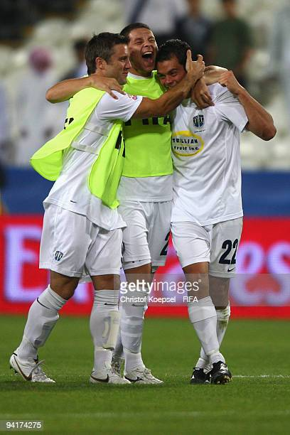 Milos Nikolic Riki van Steeden of Auckland City and Adam Dickinson of Auckland City celebrate the 20 victory after the FIFA Club World Cup match...