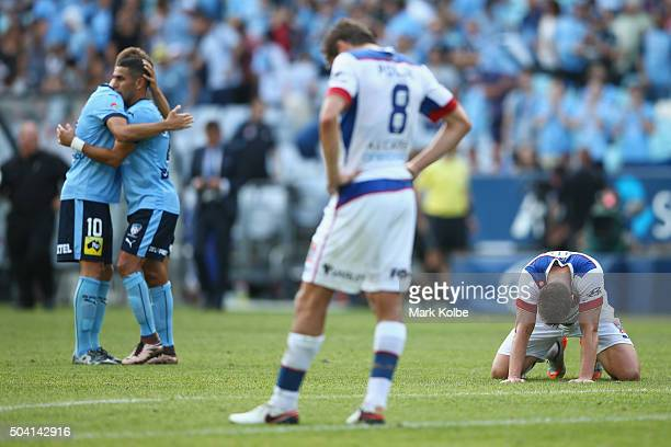 Milos Ninkovic and Ali Abbas of Sydney FC celebrate victory as Mateo Poljak and Daniel Mullen of the Jets look dejected during the round 14 ALeague...