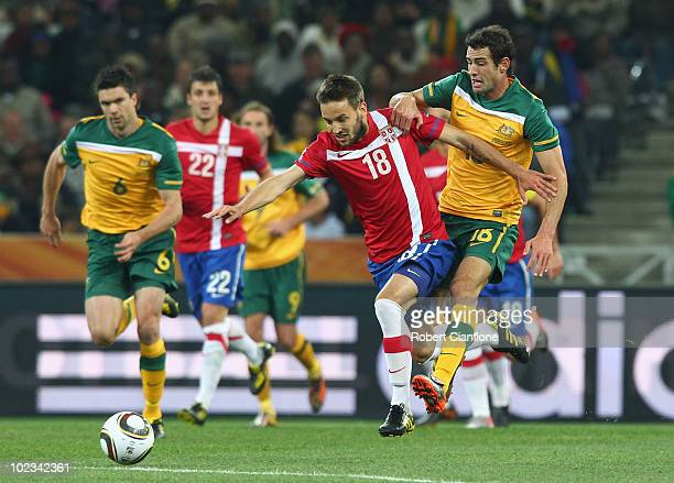 Milos Ninkovic of Serbia and Carl Valeri of Australia battle for the ball  during the 2010 8730ec338b60d