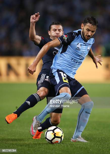 Milos Ninkovic of Sydney competes with Kosta Barbarouses of the Victory during the ALeague Semi Final match between Sydney FC and Melbourne Victory...