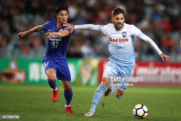Milos Ninkovic of Sydney competes with Sun Shilin of Shanghai Shenhua FC during the AFC Champions League match between Sydney FC and Shaghai Shenhua...