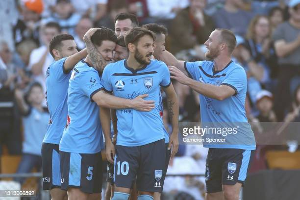 Milos Ninkovic of Sydney FC and Alexander Baumjohann of Sydney FC congratulate Bobo of Sydney FC after scoring a goal during the A-League match...
