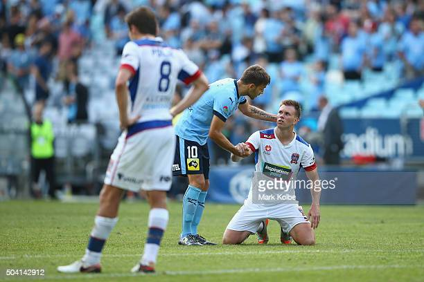 Milos Ninkovic of Sydney FC and Daniel Mullen of the Jets shake hands after the round 14 ALeague match between Sydney FC and the Newcastle Jets at...