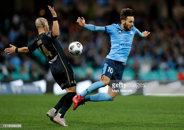 Milos Ninkovic of Sydney FC and James Troisi of the Wanderers compete for the ball during the A-League match between Sydney FC and Western Sydney...