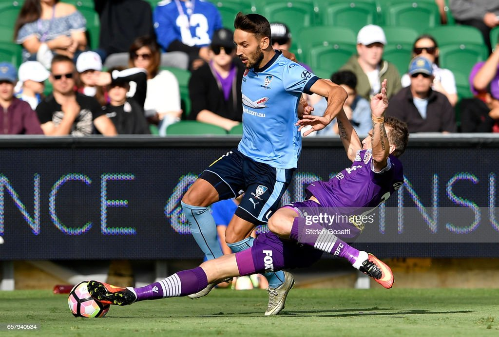Milos Ninkovic of Sydney FC and Lucian Goian of the Glory contest the ball during the round 24 A-League match between Perth Glory and Sydney FC at nib Stadium on March 26, 2017 in Perth, Australia.