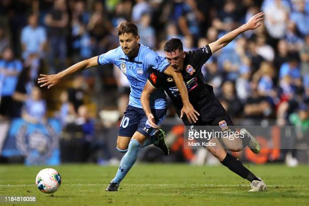 Milos Ninkovic of Sydney FC and Matt Millar of the Jets compete for the ball during the round four A-League match between Sydney FC and the Newcastle...